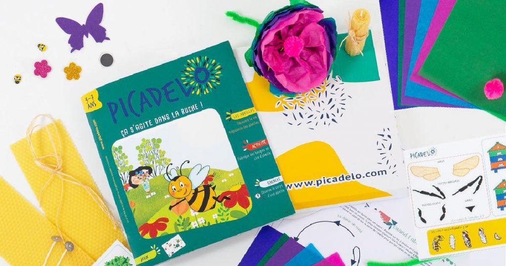 Contenu de la box Abeille - magazine, jeux activités ludiques, éducatives et créatives sur la ruche, les apiculteurs, le miel, danse des abeilles : cire, papier de soie, autocollant